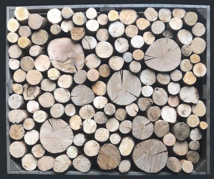 Decorative hardwood logs in a frame